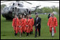 President George W. Bush walks with graduates after arriving at Oklahoma State University in Stillwater, OK where he delivered the commencement address to the class of 2006 on Saturday May 6, 2006. White House photo by Paul Morse