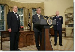 """President George W. Bush announces his nomination of Gen. Michael V. Hayden as the next Director of the Central Intelligence Agency Monday, May 8, 2006, in the Oval Office as Ambassador John Negroponte, Director of National Intelligence, looks on. Said the President of Gen. Hayden: """"He's the right man to lead the CIA at this critical moment in our nation's history."""" White House photo by Paul Morse"""