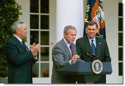 """President George W. Bush discusses America's policies regarding Cuba as Secretary of State Colin Powell, left, and Secretary of Housing and Urban Development Mel Martinez stand by his side in the Rose Garden Friday, Oct. 10, 2003. """"We will increase the number of new Cuban immigrants we welcome every year,"""" said the President. """"We are free to do so, and we will, for the good of those who seek freedom. Our goal is to help more Cubans safely complete their journey to a free land.""""  White House photo by Tina Hager"""