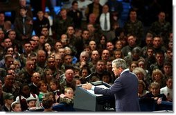 """President George W. Bush delivers remarks to the New Hampshire Air National Guard, Army National Guard, Reservists and their families at Pease Air National Guard Base in Portsmouth, N.H., Thursday, Oct. 9, 2003. """"Militia and volunteers and guardsmen have served from the Revolution to the Civil War, to World War II, to Desert Storm. Honor and service and courage are great New Hampshire traditions, and you're upholding those traditions,"""" said the President in his remarks. White House photo by Tina Hager."""