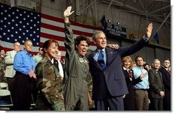 President George W. Bush is welcomed by a member of the New Hampshire Air National Guard at Pease Air National Guard Base in Portsmouth, N.H., Thursday, Oct. 9, 2003. White House photo by Tina Hager.