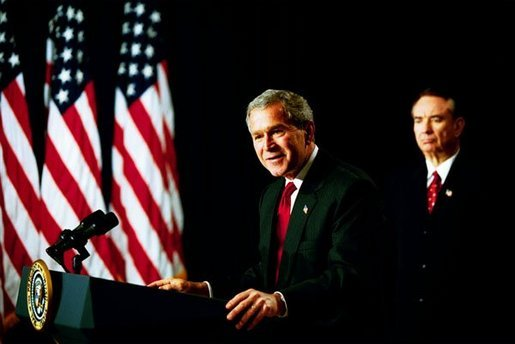 """As Health and Human Services Secretary Tommy Thompson stands by, President George W. Bush discusses Medicare in the Dwight D. Eisenhower Executive Office Building Tuesday, Oct. 29, 2003. """"The best way to provide our seniors with modern medicine, including prescription drug coverage and better preventative care, is to give them better choices under Medicare,"""" said the President talking about pending Medicare legislation White House photo by Tina Hager"""