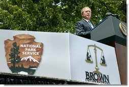 """President George W. Bush talks about segregation during the 50th anniversary of Brown V. Board of Education at the national historic site named in its honor in Topeka, Kan., Monday, May 17, 2004. """"The color of your skin determined where you could get your hair cut, which hospital ward you could be treated in, which park or library you could visit, or who you could go fishing with. And children were instructed early in the customs of racial division -- at schools where they never saw a face of another color,"""" said the President.  White House photo by Eric Draper"""