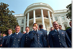 Members of the Air Force Academy football team take a picture of President Bush after he gave the team the Commander In Chief Trophy Friday morning at the White House. WHITE HOUSE PHOTO BY ERIC DRAPER