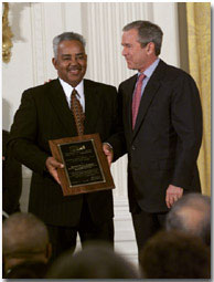 President George W. Bush stands with Thornton Stanley of Stanley Construction, Huntsville, Alabama who holds his award for the Small Business Person of the Year during a ceremony in the East Room, Tuesday, May 8. WHITE HOUSE PHOTO BY ERIC DRAPER