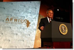 """President George W. Bush addresses the Corporate Council on Africa's U.S.- Africa Business Summit in Washington, D.C., Thursday, June 27, 2003. """"All of us here today share some basic beliefs. We believe that growth and prosperity in Africa will contribute to the growth and prosperity of the world. We believe that human suffering in Africa creates moral responsibilities for people everywhere. We believe that this can be a decade of unprecedented advancement for freedom and hope and healing and peace across the African continent,"""" President Bush said.  White House photo by Paul Morse"""