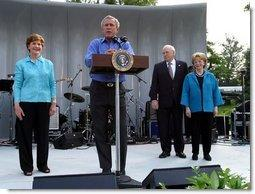 President George W. Bush shares the stage with Laura Bush, Vice President Dick Cheney and Lynne Cheney as he welcomes members of Congress and their families to the Congressional Picnic on the South Lawn Wednesday, June 18, 2003.  White House photo by Susan Sterner