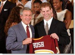 Congratulating the NCAA Winter Championship teams, President George W. Bush stands with Grant Potulny of the University of Minnesota-Twin Cities' men's hockey team in the East Room Tuesday, June 17, 2003.  White House photo by Tina Hager