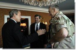 President George W. Bush discusses Iraqi reconstruction with Ambassador Paul Bremer, center, and General Tommy Franks in Doha, Qatar, Thursday, June 5, 2003.  White House photo by Eric Draper