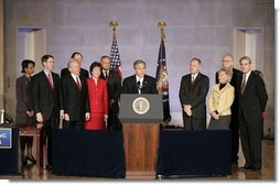 """President George W. Bush speaks during the signing ceremony of S. 2845, The Intelligence Reform and Terrorism Prevention Act of 2004, in Washington, D.C., Dec. 17, 2004. """"Under this new law, our vast intelligence enterprise will become more unified, coordinated and effective. It will enable us to better do our duty, which is to protect the American people,"""" said the President.  White House photo by Paul Morse"""