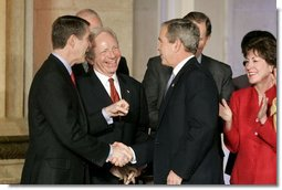 President George W. Bush talks with Senators Bill Frist, R-Tenn., right and Joe Lieberman, D-Conn., during the signing ceremony of S. 2845, The Intelligence Reform and Terrorism Prevention Act of 2004, in Washington, D.C., Dec. 17, 2004.  White House photo by Paul Morse
