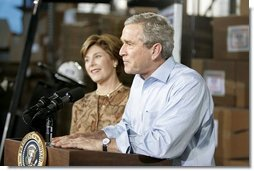 """President George W. Bush and Laura Bush visit Operation USO CarePackage at Fort Belvior, Va., Friday, Dec. 10, 2004. """"This is one way of saying, America appreciates your service to freedom and peace and our security,"""" said the President in his remarks about the program that has delivered more than 480,000 care packages.  White House photo by Paul Morse"""