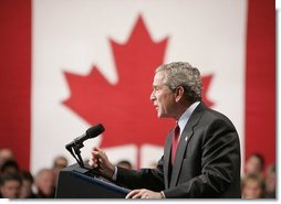 "President George W. Bush delivers a speech at Pier 21, Canada's celebrated point of immigration and military deployment, in Halifax, Canada, Dec. 1, 2004. ""I'm proud to stand in this historic place, which has welcomed home so many Canadians who defended liberty overseas, and which so many new Canadians began their North American dream,"" said the President. White House photo by Paul Morse"
