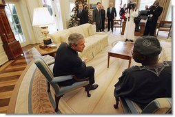 President George W. Bush talks with Nigerian President Olusegun Obasanjo in the Oval Office Thursday, Dec. 02, 2004.  White House photo by Tina Hager