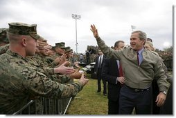 President George W. Bush greets military personnel and their families after delivering remarks at Marine Corps Base Camp Pendleton, Calif., Tuesday, Dec. 7, 2004. White House photo by Eric Draper