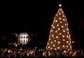 The National Christmas tree stands lit on the Ellipse in front of the White House Dec. 2, 2004. President George W. Bush and Laura Bush assisted Chantilly, Va., Girl Scout Brownies Clara Pitts and Nichole Mastracchio in lighting the 40-foot Colorado blue spruce. White House photo by Paul Morse.