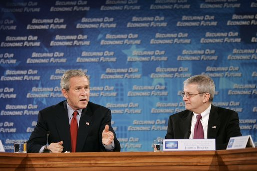 """President George W. Bush and Joshua Bolten, director of the Office of Management and Budget, talk during a White House economic conference at the Ronald Reagan Building and International Trade Center in Washington, D.C., Thursday, Dec. 16, 2004. Mr. Bolten was the moderator for the session titled """"Financial Challenges for Today and Tomorrow."""" White House photo by Paul Morse"""
