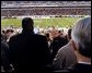 President George W. Bush looks up into the stands at Lincoln Financial Field during the 2004 Army/Navy football game in Philadelphia, Pa., Dec. 4, 2004. White House photo by Tina Hager