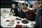 President George W. Bush and Laura Bush get a close look at some of the artifacts at the Canadian National Archives Gatineau Preservation Centre in Gatineau, Québec, Nov. 30, 2004. White House photo by Paul Morse