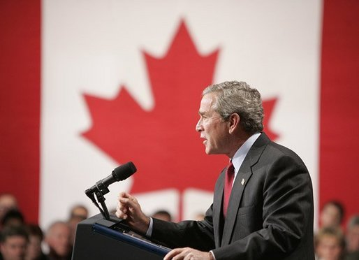 "President George W. Bush delivers a speech at Pier 21, Canada's celebrated point of immigration and military deployment, in Halifax, Canada, Dec. 1, 2004. ""I'm proud to stand in this historic place, which has welcomed home so many Canadians who defended liberty overseas, and which so many new Canadians began their North American dream,"" said the President.White House photo by Paul Morse"