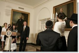 """President George W. Bush and Laura Bush watch the lighting of the Menorah at the White House Thursday, Dec. 9, 2004. """"We are honored to celebrate the miracle of Hanukkah in the White House this evening,"""" said the President.  White House photo by Paul Morse"""