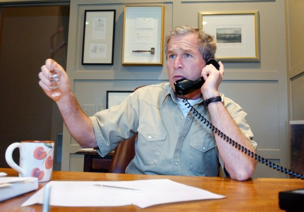 President George W. Bush discusses developments in the Middle East during a phone call with Saudi Crown Prince Abdullah, Saturday morning, March 30, 2002 at the Bush Ranch in Crawford, Texas. White House Photo by Eric Draper.
