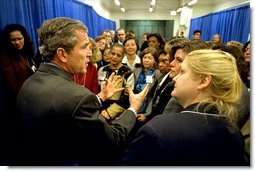 """President George W. Bush meets with participants of the women's entrepreneurship in the 21st Century Summit at the Ronald Reagan Building and International Trade Center, Washington, D.C., Tuesday, March 19. During his visit, the President unveiled plans to help small businesses across the country. """"You can dream big dreams in America, and my job as the President is to make sure that if you've got a good idea, you can realize those dreams,"""" said the President.  White House photo by Paul Morse"""