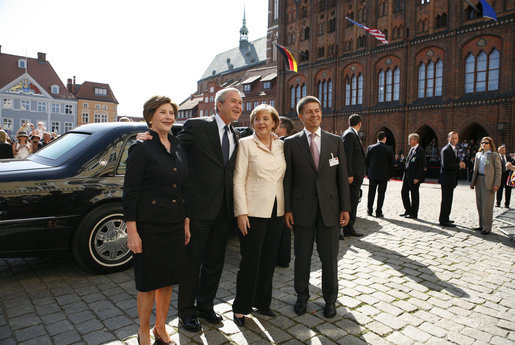 President George W. Bush and Laura Bush participate in an arrival ceremony with German Chancellor Angela Merkel and her husband Joachim Sauer in Stralsund, Germany, Thursday, July 13, 2006. White House photo by Paul Morse