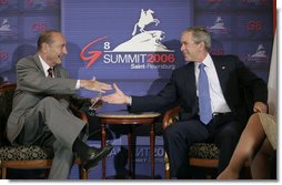"""President George W. Bush meets with President Jacques Chirac of France in a bilateral meeting during the G8 Summit in Strelna, Russia, Sunday, July 16, 2006. """"Now, I entirely agree with the American President in what he said about supporting the U.N. mission, which is designed, among other things, to ensure the release of the Israeli soldiers being detained right now both by Hezbollah and by Hamas, and put an end to the firing of Kassam rockets,"""" said President Chirac to the press. White House photo by Eric Draper"""