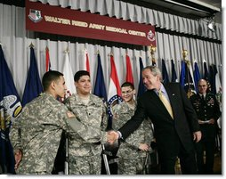 President George W. Bush shakes hands with newly sworn-in American citizens, Specialist Sergio Lopez, 24, of Bolingbrook, Ill., left, Specialist Noe Santos-Dilone of Brooklyn, N.Y., center, and Private First Class Eduardo Leal-Cardenas of Los Angeles, Calif., during their naturalization ceremony Monday, July 24, 2006, at Walter Reed Army Medical Center in Washington, D.C. White House photo by Eric Draper