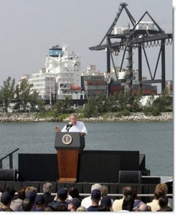 """President George W. Bush addresses an audience on America's economy at the U.S. Coast Guard Integrated Support Command at the Port of Miami Monday, July 31, 2006. """"It's an honor to be here at the largest container port in Florida and one of the most important ports in our nation,"""" said President Bush. """"From these docks, ships loaded with cargo deliver products all around the world carrying that label """"Made in the USA.""""'  White House photo by Kimberlee Hewitt"""