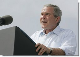 """President George W. Bush discusses America's economy at the U.S. Coast Guard Integrated Support Command at the Port of Miami Monday, July 31, 2006. """"It's an honor to be here at the largest container port in Florida and one of the most important ports in our nation,"""" said President Bush.  White House photo by Kimberlee Hewitt"""
