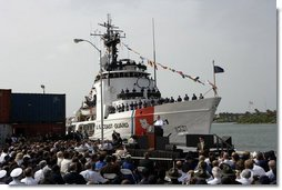 """President George W. Bush discusses America's economy at the U.S. Coast Guard Integrated Support Command at the Port of Miami Monday, July 31, 2006. """"It's an honor to be here at the largest container port in Florida and one of the most important ports in our nation,"""" said President Bush. """"From these docks, ships loaded with cargo deliver products all around the world carrying that label """"Made in the USA.""""' White House photo by Kimberlee Hewitt"""