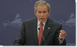 President George W. Bush emphasizes a point as he responds to a question Saturday, July 15, 2006, during a joint press availability with President Vladimir Putin of Russia at the International Media Center on the grounds of the Konstantinovsky Palace Complex, site of the G8 Summit in Strelna, Russia. White House photo by Paul Morse