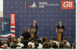 President George W. Bush and President Vladimir Putin of Russia, answer questions from reporters during a joint press availability at the International Media Center at the Konstantinovsky Palace Complex in Strelna, Russia, site of the 2006 G8 Summit. White House photo by Paul Morse