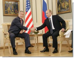 President George W. Bush and Russia's President Vladimir Putin shake hands before their G8 bilateral meeting Saturday, July 15, 2006, at the Konstantinovsky Palace Complex in Strelna, Russia.  White House photo by Eric Draper