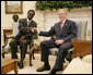 President George W. Bush welcomes Sudanese Liberation Movement leader Minni Minnawi to the Oval Office Tuesday, July 25, 2006, in Washington, D.C., meeting to discuss the Darfur region of western Sudan. White House photo by Kimberlee Hewitt