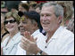 President George W. Bush and Laura Bush are joined by baseball legend and hall of famer Willie Mays, Tee Ball Commissioner for the day Sunday, July 30, 2006, at the Tee Ball on the South Lawn game between the Thurmont Little League Civitan Club of Frederick Challengers of Thurmont, Md., and the Shady Spring Little League Challenger Braves of Shady Spring, W. Va. White House photo by Paul Morse