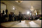 """President George W. Bush walks into the East Room for a press conference in Wednesday, Oct. 25, 2006. """"Our security at home depends on ensuring that Iraq is an ally in the war on terror and does not become a terrorist haven like Afghanistan under the Taliban,"""" said President Bush. White House photo by Paul Morse"""