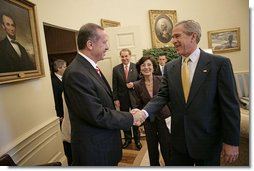 President George W. Bush welcomes Prime Minister Recep Tayyip Erdogan of Turkey to the Oval Office Monday, October 2, 2006.  White House photo by Eric Draper