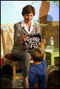 """Mrs. Laura Bush calls on a young member of the audience to speak after she finished reading the book, """"The Spider and the Fly"""" by Mary Howitt, illustrated by Tony DiTerlizzi, during a visit to the West Palm Beach Public Library in West Palm Beach, Fla., Friday, Oct. 27, 2006. The Library began its reading room in a congregational church in 1894, and has grown to have over one hundred-thousand books in their collection. White House photo by Shealah Craighead"""