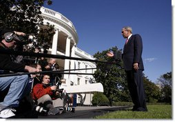 President George W. Bush comments on the passing of a resolution by the United Nations concerning the actions of North Korea before departing the White House on October 14, 2006. White House photo by Paul Morse