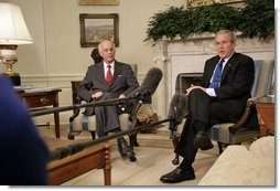 """President George W. Bush and Andrew Natsios, Presidential Special Envoy for Sudan, meet with the press in the Oval Office Tuesday, Oct. 31, 2006. """"The situation in Darfur is on our minds,"""" said the President. """"The people who have suffered there need to know that the United States will work with others to help solve the problem."""" White House photo by Kimberlee Hewitt"""