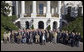 """President George W. Bush stands for a photograph with veterans of the 57th Bomb Wing from World War II on the South Portico Friday, Oct. 13, 2006. Approximately 10,800 airmen passed through the portals of the 57th Bomb Wing, a command composed of B-25 Mitchell medium bombers, during its time in combat from 1942 to 1945 in North Africa, Sicily, Corsica, and Italy. The B-25 Mitchell's and their crews were known for their ability to take out bridges, gun positions, and for disrupting enemy troop communications. The 57th was nicknamed, """"The Bridge Busters."""" The members are in Washington, D.C., for their association's annual reunion Oct. 11-16, 2006. White House photo by Paul Morse"""