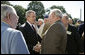 """President George W. Bush welcomes veterans of the 57th Bomb Wing from World War II to the White House, Friday, Oct. 13, 2006. Approximately 10,800 airmen passed through the portals of the 57th Bomb Wing, a command composed of B-25 Mitchell medium bombers, during its time in combat from 1942 to 1945 in North Africa, Sicily, Corsica, and Italy. The B-25 Mitchell's and their crews were known for their ability to take out bridges, gun positions, and for disrupting enemy troop communications. The 57th was nicknamed, """"The Bridge Busters."""" The members are in Washington, D.C., for their association's annual reunion Oct. 11-16, 2006. White House photo by Eric Draper"""