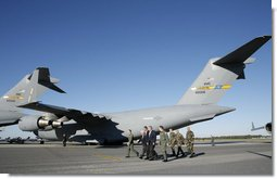 President George W. Bush walks past C-17 aircraft before addressing military personnel and their families at Charleston Air Force Base in Charleston, South Carolina on Saturday, October 28, 2006. White House photo by Paul Morse