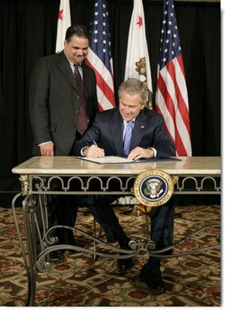 President George W. Bush signs S. 260, The Partners for Fish and Wildlife Act, in Stockton, Calif., Tuesday, Oct. 3, 2006. Pictured with President Bush is Congressman Richard Pombo, R-Ca. The legislation provides assistance to private landowners for voluntary projects to benefit federal trust species by promoting habitat improvement, restoration, enhancement, and establishment; and other public and private entities regarding fish and wildlife habitat restoration on private land.  White House photo by Eric Draper