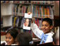 A student holds up a book about President George W. Bush during the President's visit to the elementary school named after him in Stockton, Calif., Tuesday, Oct. 3, 2006. White House photo by Eric Draper