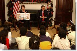 "President George W. Bush and Laura Bush read ""'Twas the Night Before Christmas,"" to a class of third-graders during the White House Story Hour in the Roosevelt Room Tuesday, Dec. 17.  White House photo by Tina Hager"