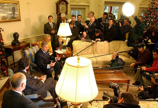 President George W. Bush and President Jose Aznar of Spain make a joint statement to the media in the Oval Office Wednesday, Dec. 18. White House photo by Tina Hager
